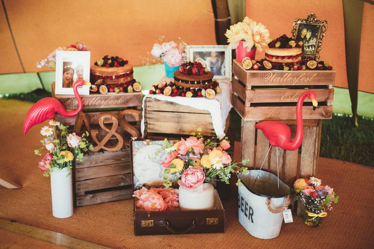 Wooden Crate Homemade Cake Table | Bright Festival Themed Outdoor Ceremony & Tipi Weeding |  Maryanne Weddings | Framed Beauty Film