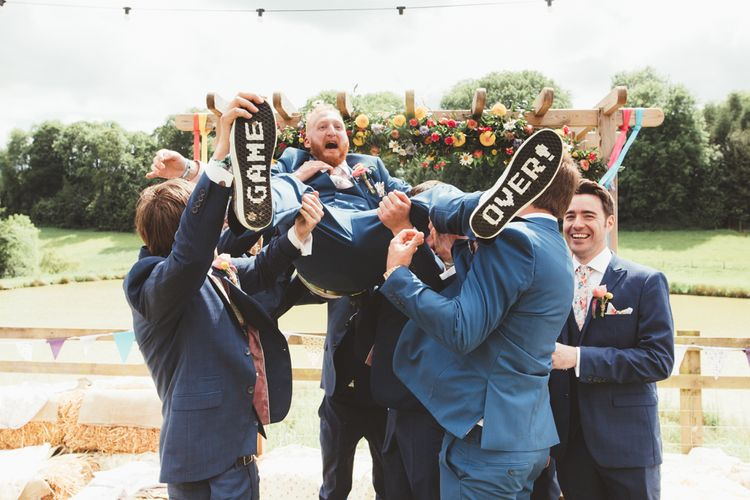 Groomsmen in Navy Suits | Groom in Vans with Game Over Soles | Bright Festival Themed Outdoor Ceremony & Tipi Weeding |  Maryanne Weddings | Framed Beauty Film