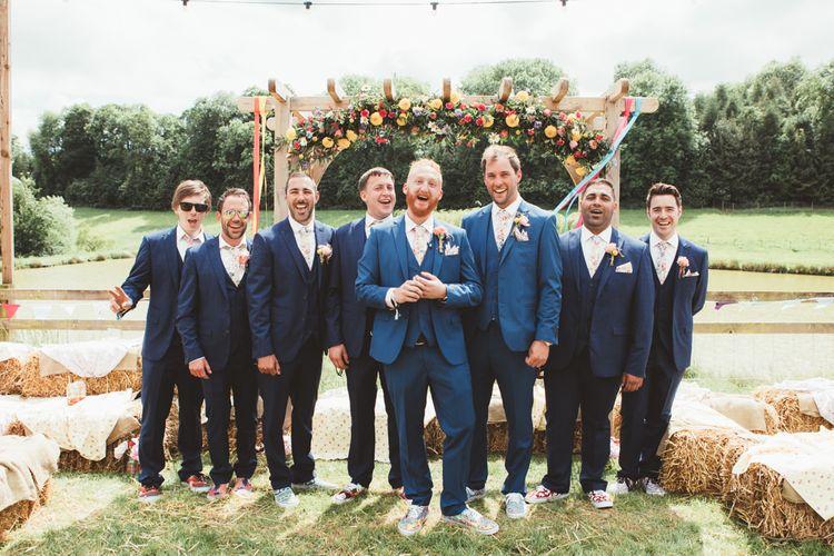 Groomsmen in Navy Suits | Bright Festival Themed Outdoor Ceremony & Tipi Weeding |  Maryanne Weddings | Framed Beauty Film
