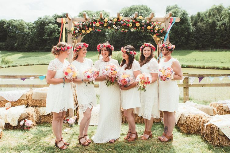 Bridal Party | Flower Crowns | Bridesmaids in Different White Dresses | Bride in Watters Gown | Bright Festival Themed Outdoor Ceremony & Tipi Weeding |  Maryanne Weddings | Framed Beauty Film