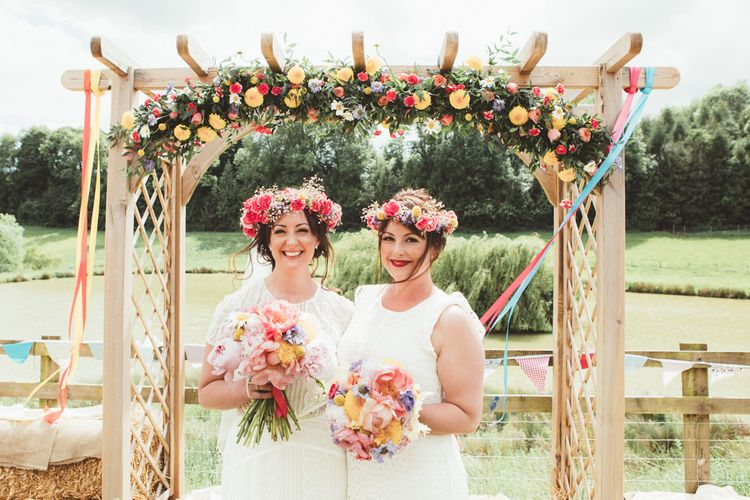 Bride & Bridesmaids in Colourful Flower Crowns | Bright Festival Themed Outdoor Ceremony & Tipi Weeding |  Maryanne Weddings | Framed Beauty Film