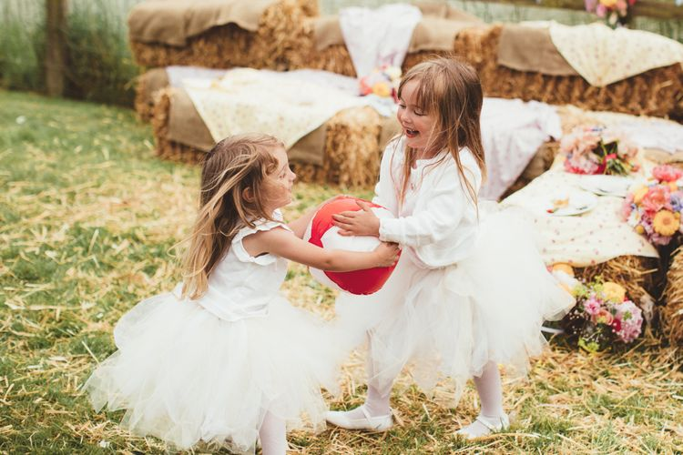 Flower Girls in Monsoon Kids Tutus | Bride in Lace Watters Gown & Colourful Flower Crown | Groom in Navy Suit | Bright Festival Themed Outdoor Ceremony & Tipi Weeding |  Maryanne Weddings | Framed Beauty Film