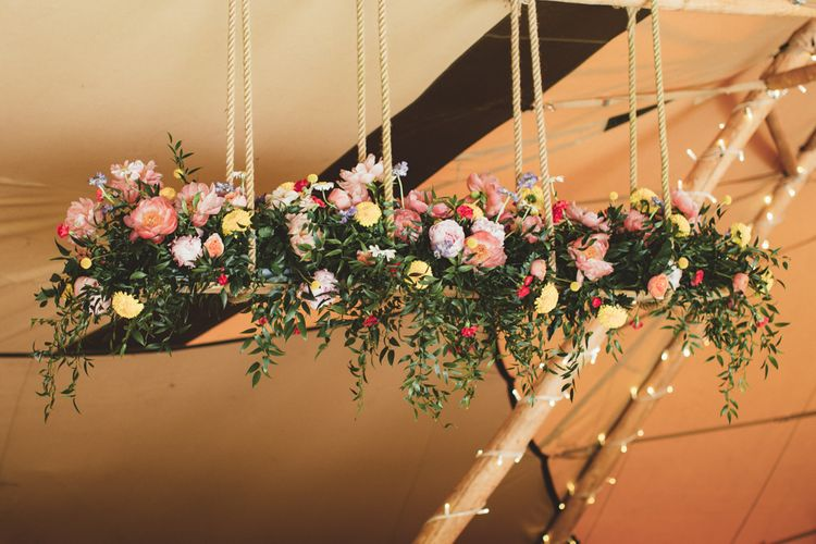 Hanging Floral Installation with Peonies | Bright Festival Themed Outdoor Ceremony & Tipi Weeding |  Maryanne Weddings | Framed Beauty Film