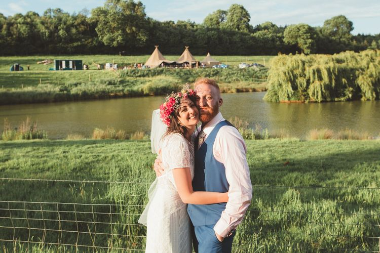 Bride in Lace Watters Wedding Dress | Groom in Navy Suit | Bright Festival Themed Outdoor Ceremony & Tipi Weeding |  Maryanne Weddings | Framed Beauty Film