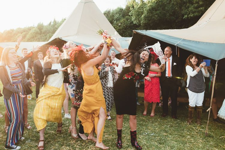 Bouquet Toss | Bright Festival Themed Outdoor Ceremony & Tipi Weeding | Maryanne Weddings | Framed Beauty Film