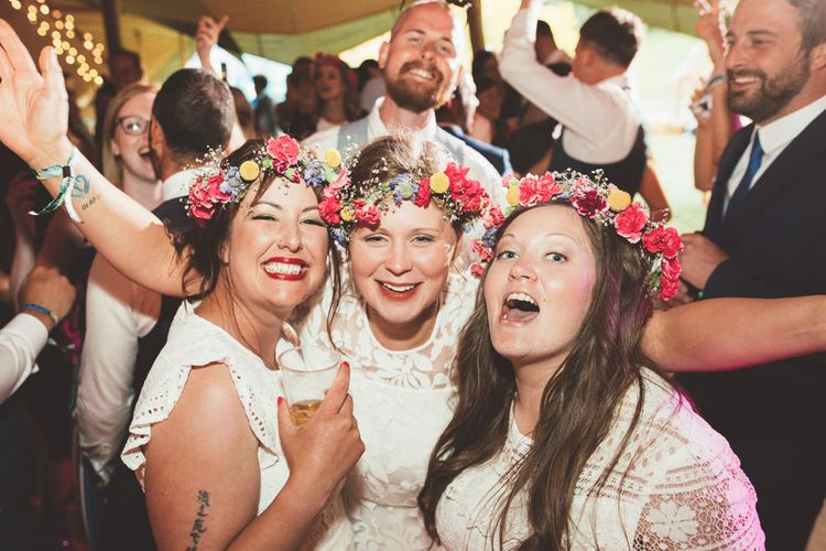 Bridesmaids in White Dresses & Colourful Flower Crowns | Bright Festival Themed Outdoor Ceremony & Tipi Weeding | Maryanne Weddings | Framed Beauty Film