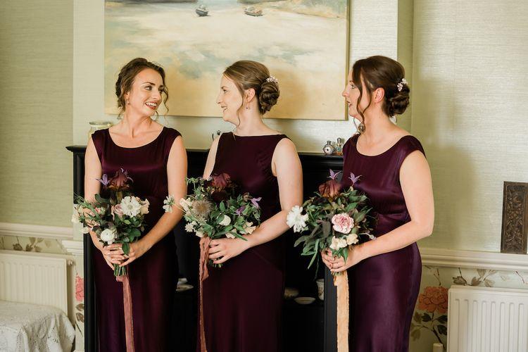 Bridesmaids in Purple Satin Dresses on the Wedding Morning