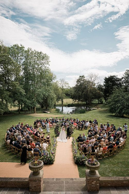 Outdoor Wedding Ceremony with Central Moon Gate Altar