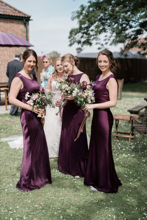 Bridesmaids in Long Satin Purple Dresses from Ghost Fashion