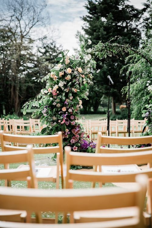 Outdoor Wedding Ceremony with Lilac, Peach and Foliage Moon Gate  Altar