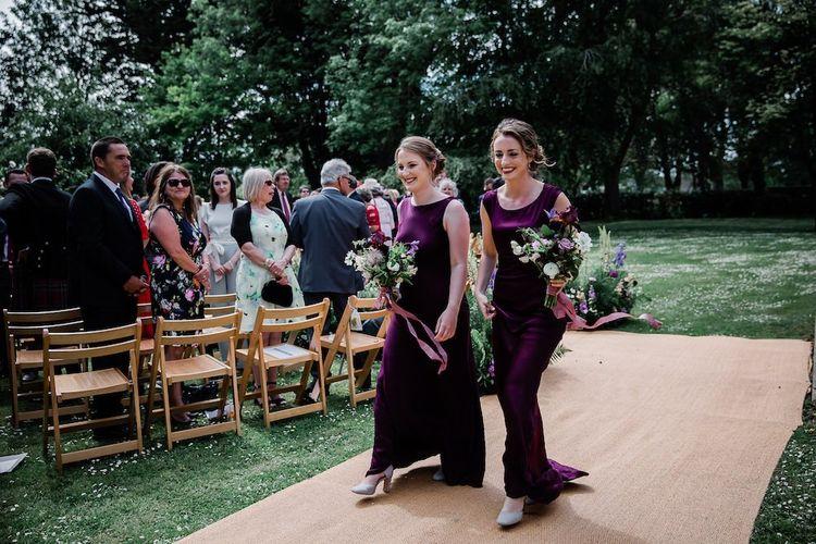 Bridesmaids in Ghost Deep Purple Satin Bridesmaids Dresses Walking Down the Aisle