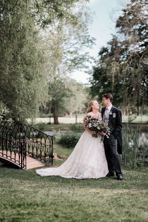 Bride in Lace Sophia Tolli Wedding Dress and Groom in Traditional Tails