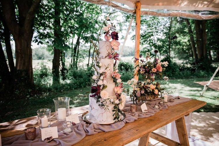 Wedding Cake Table with Summer Flower Arrangement