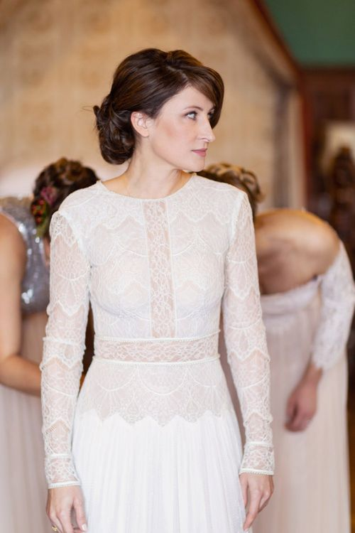 Wedding Morning Bridal Preparations with Bridesmaids Helping The Bride into her Lace Lihi Hod Sophia Wedding Dress