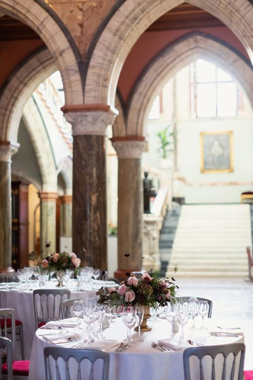 Round Wedding Reception Tables with Winter Flower Centrepieces at Mount Stuart  in Scotland