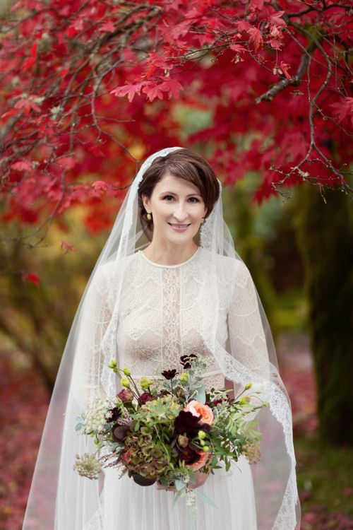 Bride in Delicate Lace Lihi Hod Sophia Wedding Dress with Long Sleeves and Lace Edged Veil