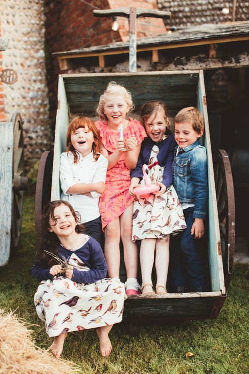 Little Wedding Guests Sitting in a Cart Playing