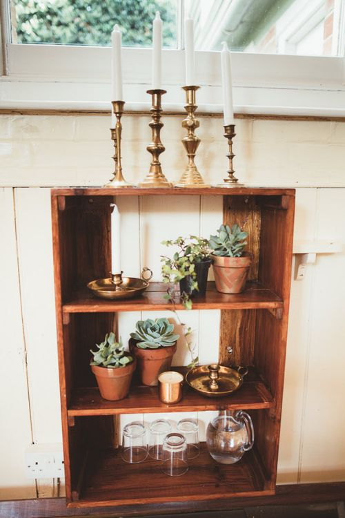 Wooden Shelf with Succulent Plant Pots and Gold Candle Sticks