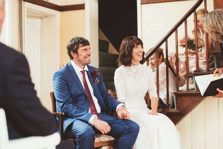 Bride in Lace Wedding Dress from Hope & Harlequin and Groom in  Navy Hugo Boss Suit