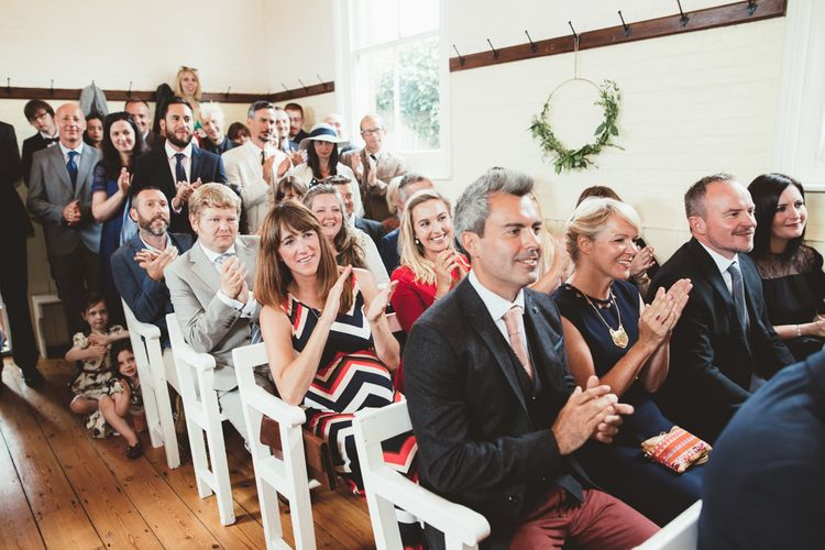 Wedding Guests Clapping During Wedding Ceremony