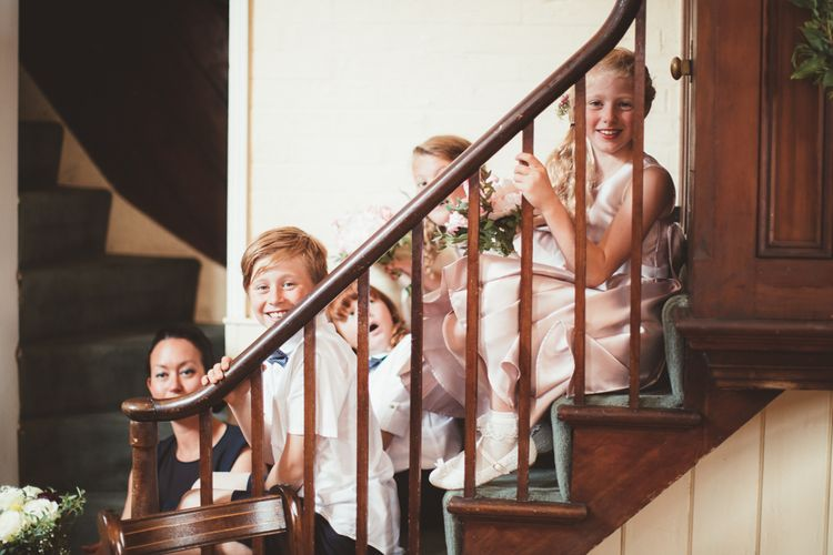 Flower Girls and Page Boys Sitting on the Stairs