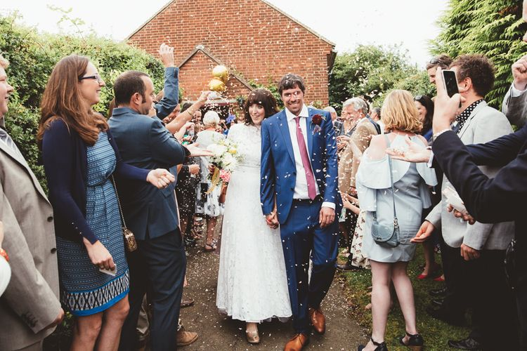 Confetti Moment with Bride in Lace Wedding Dress from Hope & Harlequin and Groom in Navy Hugo Boss Suit