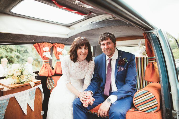 Bride in Lace Wedding Dress from Hope & Harlequin and Groom in Navy Hugo Boss Suit  Sitting in VW Camper Van Wedding Car