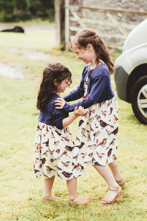 Little Girls in Bird Print Dresses and Navy Cardigans
