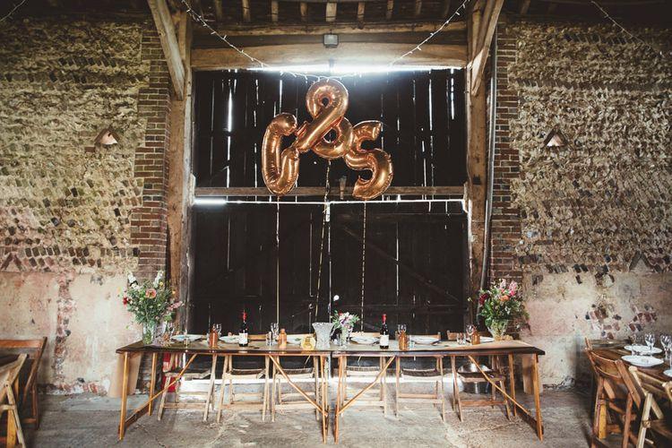 Montague Farm Barn Wedding Reception Decor with Copper Foil Balloons