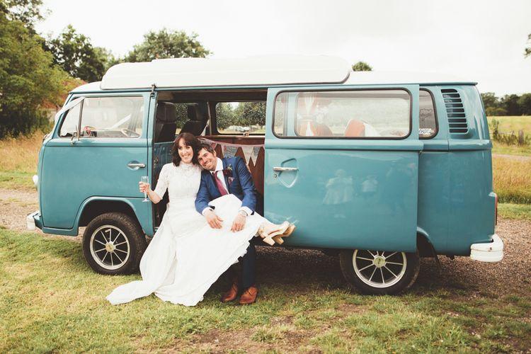 Bride in Lace Wedding Dress from Hope & Harlequin and Groom in Navy Hugo Boss Suit in VW Camper Van