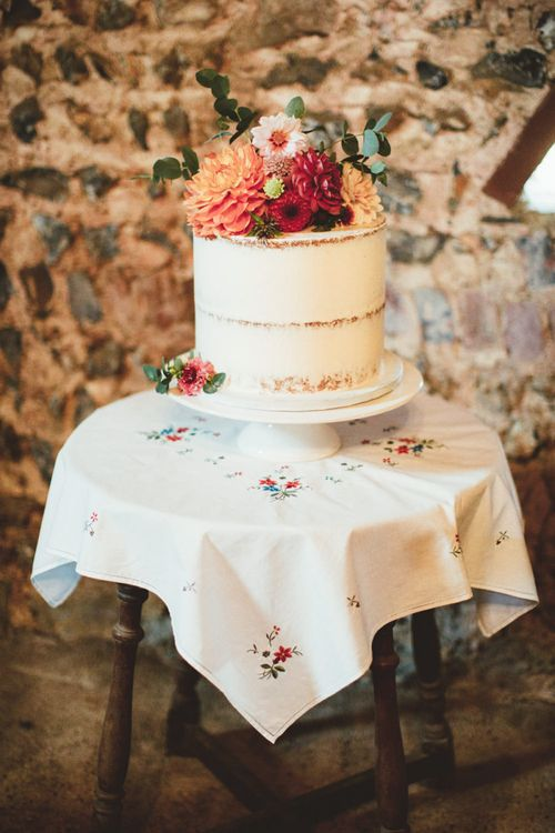 Single Tier Semi Naked Wedding Cake with Bright Dahlia  Fresh Flower Topper