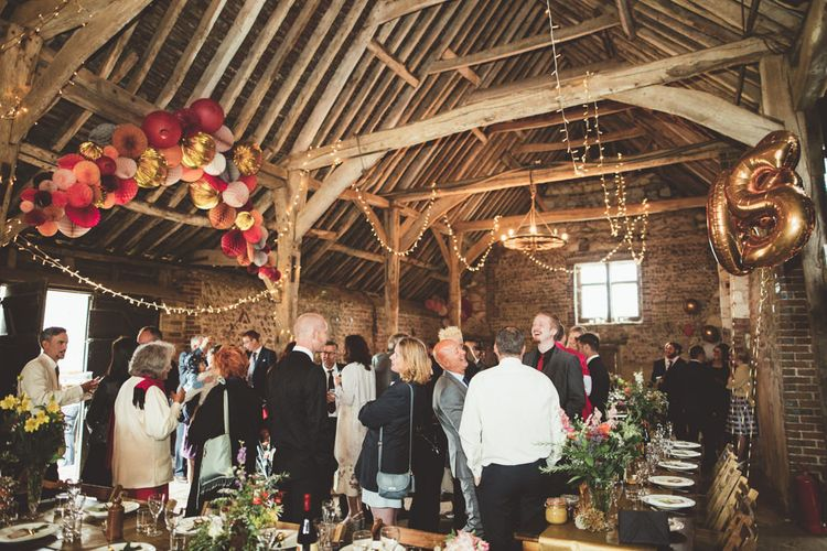 Montague Farm Barn Wedding Reception Decor with Pom Pom Arch, Fairy Lights and Balloon Wedding Decor