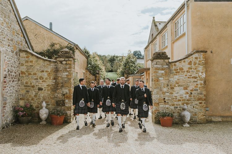 Groom & Groomsmen In Kilts // Scottish Wedding With Ceilidh At Axnoller Dorset With Bohemian Styling Outdoor Wedding Ceremony With Images From Paul Underhill Dorset Wedding Photographer