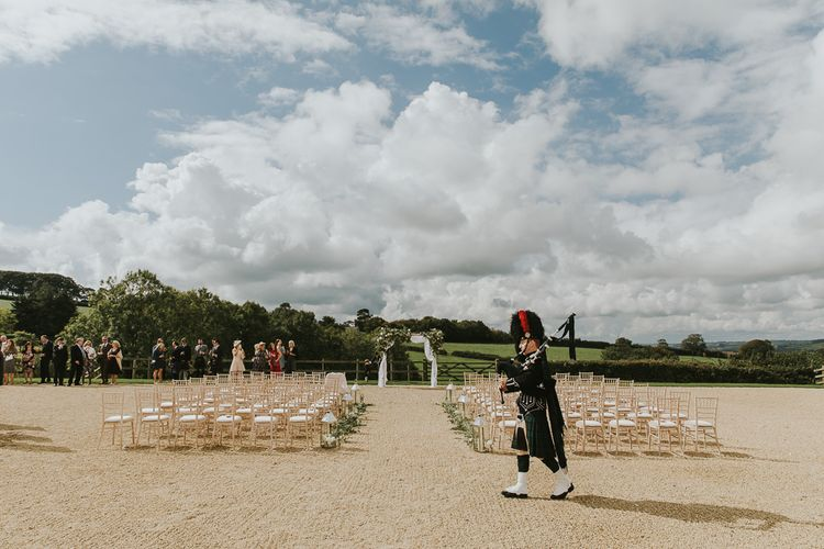Scottish Bag Piper For Dorset Wedding // Scottish Wedding With Ceilidh At Axnoller Dorset With Bohemian Styling Outdoor Wedding Ceremony With Images From Paul Underhill Dorset Wedding Photographer
