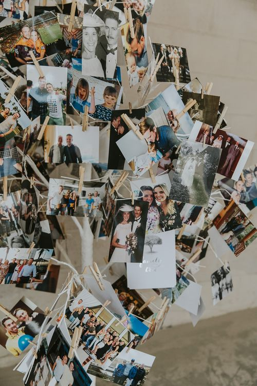 Family Photo Display For Wedding // Scottish Wedding With Ceilidh At Axnoller Dorset With Bohemian Styling Outdoor Wedding Ceremony With Images From Paul Underhill Dorset Wedding Photographer