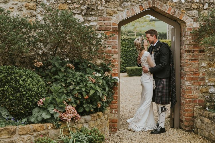 Groom In Kilt // Scottish Wedding With Ceilidh At Axnoller Dorset With Bohemian Styling Outdoor Wedding Ceremony With Images From Paul Underhill Dorset Wedding Photographer