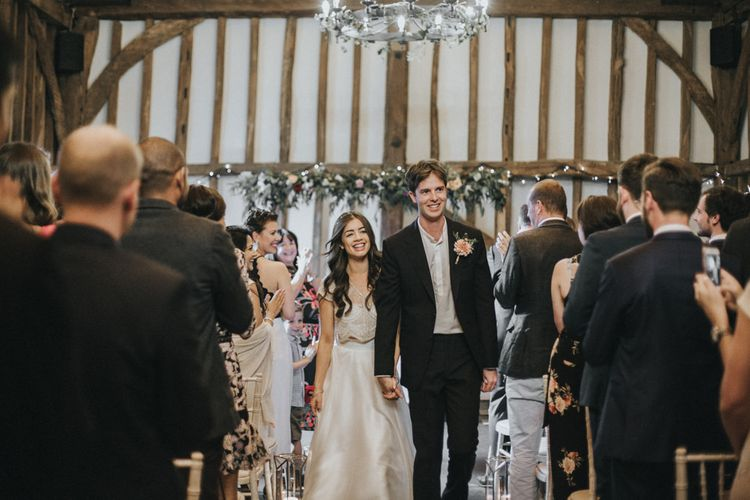 Wedding Ceremony | Bride in Embellished Suzanne Neville Separates via The Mews Boutique | Groom in Gieves and Hawkes Suit | Intimate Wedding at The Olde Bell Pub, Berkshire | Revival Rooms Floral Design, Decor & Styling | Grace Elizabeth Photo & Film