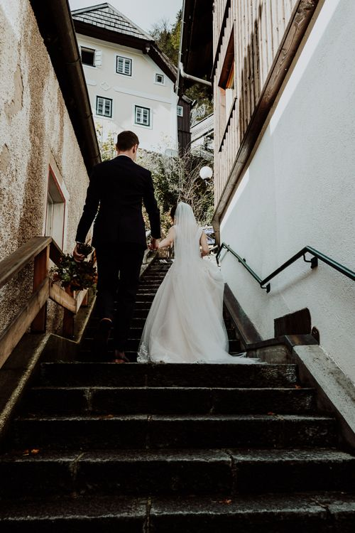 Bride and Groom Walking Up the Steps in Hallstatt, Austria
