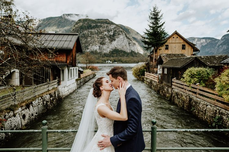 Bride and Groom Kissing on a Bridge in Hallstatt, Austria