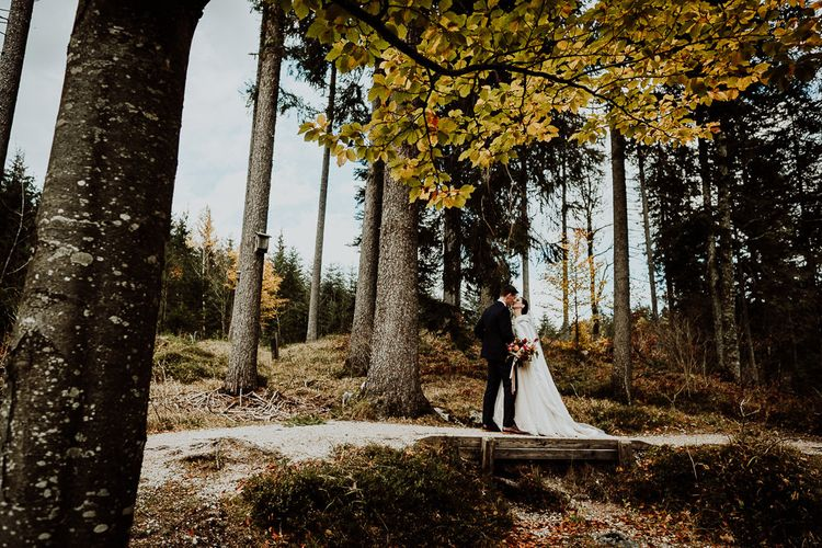 Bride and Groom Wedding Portrait in the Woods with Tall Trees