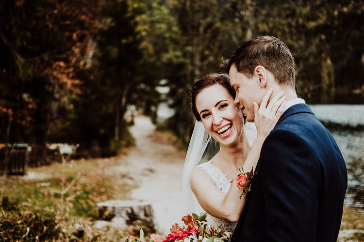 Groom Kissing his Laughing Brides Cheek