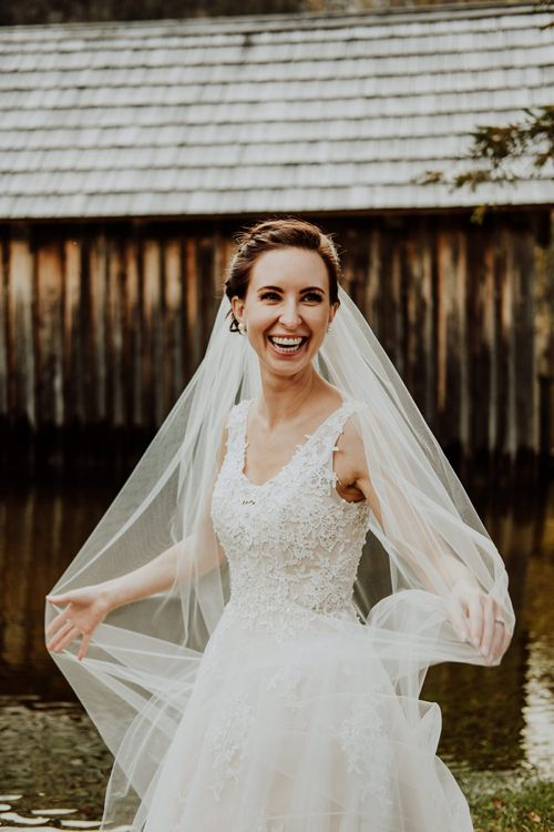 Happy Bride Twirling in Her Wedding Dress and Veil