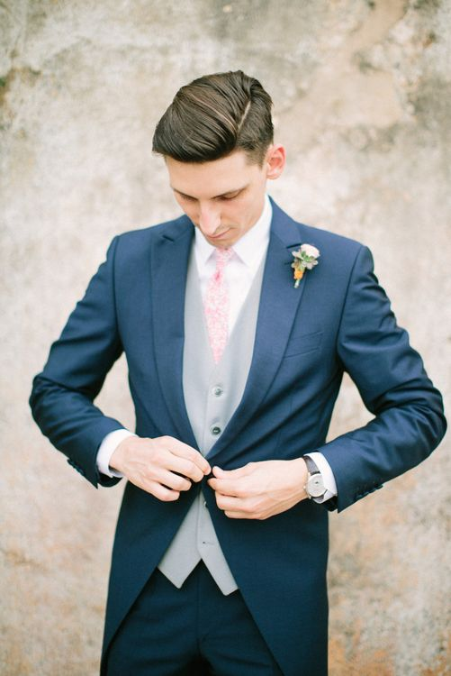 Groom in Navy Three-Piece Suit with Grey Waistcost