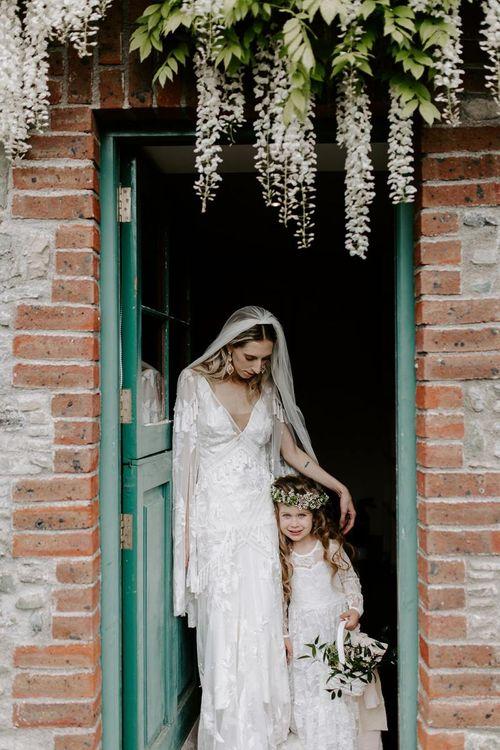 Bride with flower girl at Irish wedding