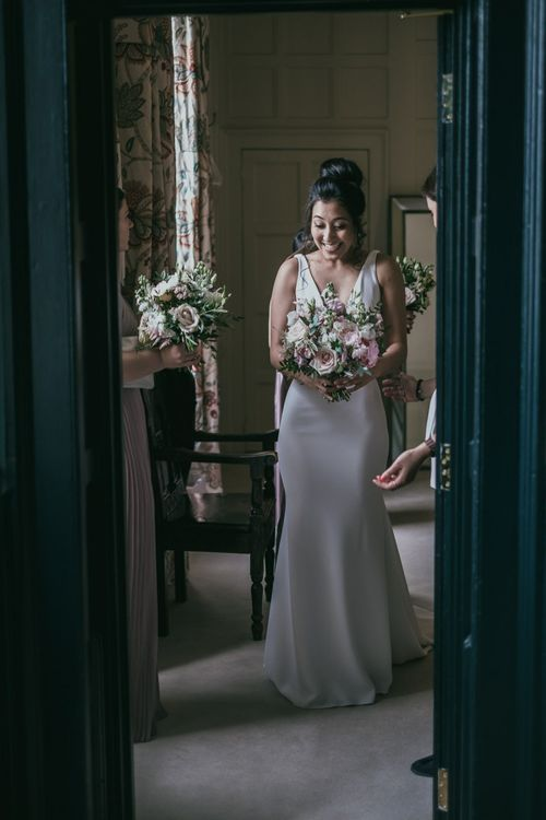 Beautiful Bride in a Pronovias Fitted Wedding Dress Holding a Pink and White Wedding Bouquet