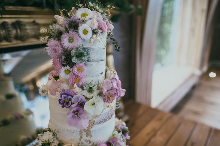 Semi Naked Wedding Cake with Trailing Pink Flower Decor