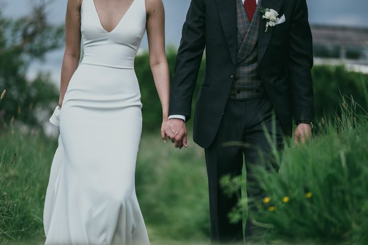Fitted Pronovias Wedding Dress and Cad & The Dandy Suit with Plaid Waistcoat