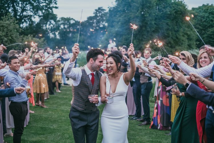 Sparkler Moment with Bride in Fitted Wedding Dress and Groom in Plaid Cad & The Dandy Waistcoat