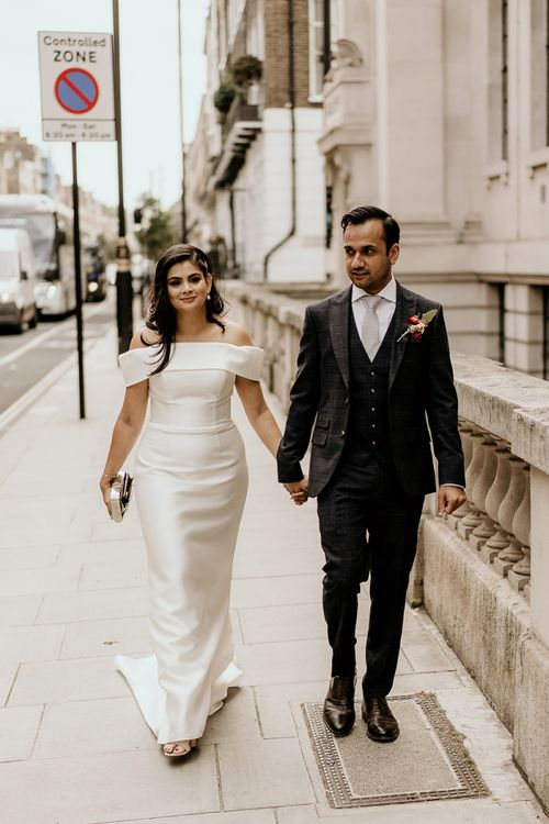 Bride and groom walking together to their Old Marylebone Town Hall wedding ceremony