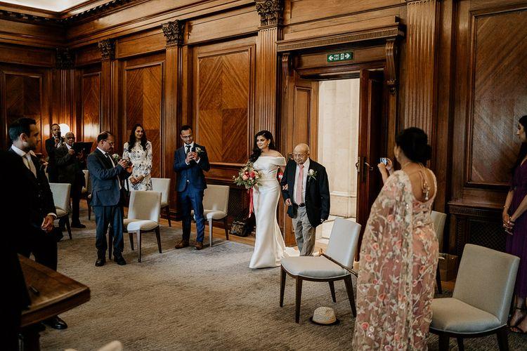 Wedding ceremony bridal entrance with her Grandad